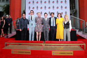 """(L-R) Johnny Galecki, Jim Parsons, Kaley Cuoco, Simon Helberg, Kunal Nayyar, Mayim Bialik and Melissa Rauch from the cast of """"The Big Bang Theory"""" attend their handprint ceremony at the TCL Chinese Theatre IMAX  on May 1, 2019 in Hollywood, California."""