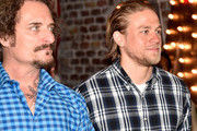 Actors Kim Coates (L) and Charlie Hunnam attend Cast of FX's 'Sons of Anarchy' Host 'Boot Bash' benefiting The Boot Campaign at The Bunker Lofts on August 2, 2014 in Los Angeles, California.