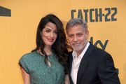 Amal Alamuddin and George Clooney attend 'Catch-22' Photocall, a Sky production, at The Space Moderno Cinema on May 13, 2019 in Rome, Italy.