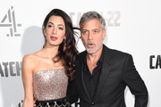 "Amal Clooney and George Clooney attend the ""Catch 22"" UK premiere on May 15, 2019 in London, United Kingdom."