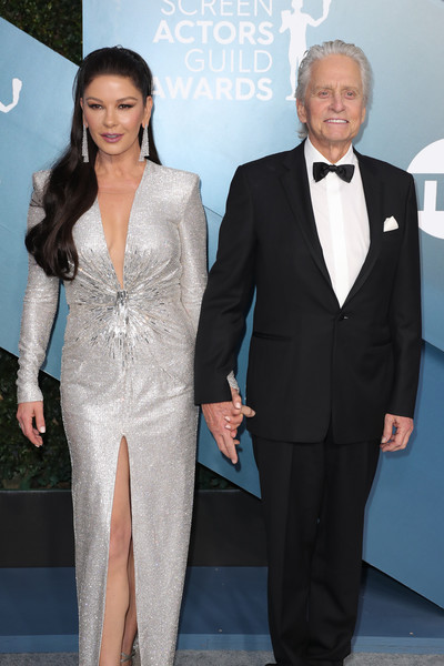 26th Annual Screen ActorsGuild Awards - Arrivals [suit,clothing,formal wear,tuxedo,pantsuit,fashion,event,white-collar worker,carpet,dress,arrivals,michael douglas,catherine zeta-jones,screen actors guild awards,l-r,california,los angeles,the shrine auditorium,catherine zeta-jones,michael douglas,actor,shrine auditorium and expo hall,screen actors guild award ceremony,screen actors guild award for outstanding performance by a cast in a motion picture,getty images,photography,sag-aftra]