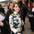 Alison Brie wore a cute jacket and stayed hydrated.