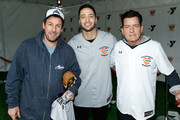 "Adam Sandler, Ryan Braun and Charlie Sheen attend a charity softball game to benefit ""California Strong"" at Pepperdine University on January 13, 2019 in Malibu, California."