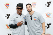"""Jamie Foxx and Ryan Braun attend a charity softball game to benefit """"California Strong"""" at Pepperdine University on January 13, 2019 in Malibu, California."""