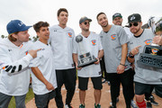 """Patrick Schwarzenegger, Mike Attanasio, Christian Yelich, Ryan Braun and Mike Moustakas on the field at a charity softball game to benefit """"California Strong"""" at Pepperdine University on January 13, 2019 in Malibu, California."""