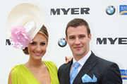 Kris Smith (R) and Laura Dundovica pose for a photo at the VIP marquee on Magic Millions Race-day at the Gold Coast Turf Club on January 14, 2012 in Gold Coast, Australia.