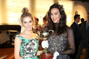 Kate Waterhouse and Megan Gale pose with the 2018 Melbourne Cup at the Lexus Design Pavilion Marquee on Melbourne Cup Day at Flemington Racecourse on November 6, 2018 in Melbourne, Australia.