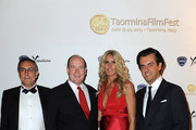 (L to R) Mario Sesti, Price Albert II of Monaco, Tiziana Rocca and Michelle Curatolo attend the Lancia Cafe during the Taormina Filmfest 2013 on June 16, 2013 in Taormina, Italy.