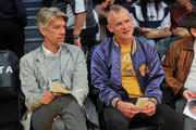 Screenwriter Stephen Gaghan and musician Flea (R) attend a basketball game between the Los Angeles Lakers and the Memphis Grizzlies at Staples Center on December 27, 2017 in Los Angeles, California.