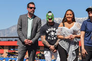 Dave Allen, Rey Mysterio and Adrienne Bailon attend the Monster Energy NASCAR Cup Series race at Auto Club Speedway at Auto Club Speedway on March 17, 2019 in Fontana, California.