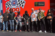 Vince Neil, Nikki Sixx, Tommy Lee, Mick Mars, Machine Gun Kelly and Douglas Booth attend the Monster Energy NASCAR Cup Series race at Auto Club Speedway at Auto Club Speedway on March 17, 2019 in Fontana, California.