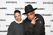 """(EXCLUSIVE COVERAGE)  Joseph """"Rev Run"""" Simmons and his wife Justine Simmons (L) visit the SiriusXM Studios on March 06, 2020 in New York City."""