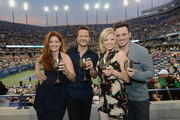 (L-R) Actress Debra Messing, Will Chase, Megan Hilty and Brian Gallagher attend the Moet & Chandon Suite at USTA Billie Jean King National Tennis Center on August 30, 2013 in New York City.
