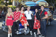 "In this handout photo provided by Disney Parks, Mollee Gray, Garrett Clayton, Maia Mitchell, Ross Lynch, Grace Phipps and John DeLuca of the hit Disney Channel Original Movie ""Teen Beach Movie"" perform a medley of songs during a taping for the 'Disney Parks Christmas Day Parade' television special at Disneyland on November 10, 2013 in Anaheim, California. 'Disney Parks Christmas Day Parade' airs December 25 on ABC."
