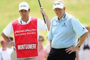 Colin Montgomerie of Scotland stands with his caddie Jason Hempelman on the first hole during the second round of the Celtic Manor Wales Open on The Twenty Ten Course at The Celtic Manor Resort on June 4, 2010 in Newport, Wales.