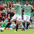 Gary Hooper Photos - Gary Hooper of Celtic scores during the Clydesdale Bank Scottish Premier League match between Celtic and Dundee on September 22, 2012 in Glasgow, Scotland. - Celtic v Dundee - Scottish Premier League