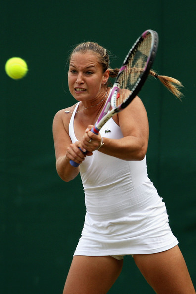 Dominika Cibulkova of Slovakia plays a backhand during the women's singles third round match against Elena Vesnina of Russia on Day Five of the Wimbledon Lawn Tennis Championships at the All England Lawn Tennis and Croquet Club on June 26, 2009 in London, England.