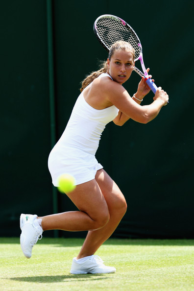 Dominika Cibulkova of Slovakia plays a backhand during the women's singles second round match against Urszula Radwanska of Poland on Day Three of the Wimbledon Lawn Tennis Championships at the All England Lawn Tennis and Croquet Club on June 24, 2009 in London, England.