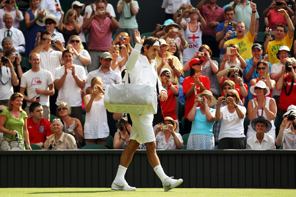 Roger Federer of Switzerland arrives on Centre Court ahead of his match against Arnaud Clement of France on Day Five of the Wimbledon Lawn Tennis Championships at the All England Lawn Tennis and Croquet Club on June 25, 2010 in London, England.