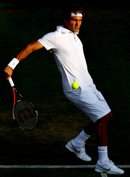 Roger Federer of Switzerland in action winning his second round match against Ilija Bozoljac of Serbia on Day Three of the Wimbledon Lawn Tennis Championships at the All England Lawn Tennis and Croquet Club on June 23, 2010 in London, England.
