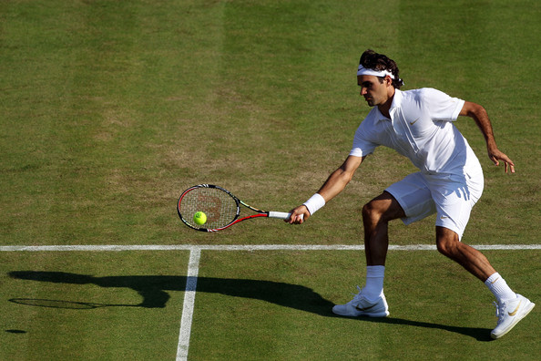 Roger Federer of Switzerland in action during his second round match against Ilija Bozoljac of Serbia on Day Three of the Wimbledon Lawn Tennis Championships at the All England Lawn Tennis and Croquet Club on June 23, 2010 in London, England.