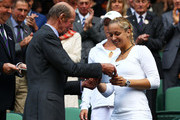 Prince Edward, Duke of Kent presents  Sabine Lisicki of Germany and Samantha Stosur of Australia their trophies after their final round Ladies' doubles match against Kveta Peschke of the Czech Republic and Katarina Srebotnik of Slovenia  on Day Twelve of the Wimbledon Lawn Tennis Championships at the All England Lawn Tennis and Croquet Club on July 2, 2011 in London, England.