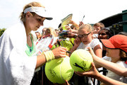 Sabine Lisicki of Germany signs autographs for fans after a practice session on day eleven of the Wimbledon Lawn Tennis Championships at the All England Lawn Tennis and Croquet Club on July 5, 2013 in London, England.
