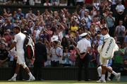 Novak Djokovic of Serbia and Juan Martin Del Potro of Argentina leave Centre Court after their Gentlemen's Singles semi-final match against Juan Martin Del Potro of Argentina on day eleven of the Wimbledon Lawn Tennis Championships at the All England Lawn Tennis and Croquet Club on July 5, 2013 in London, England.