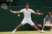 Novak Djokovic of Serbia slides to play a forehand during the Gentlemen's Singles semi-final match against Juan Martin Del Potro of Argentina on day eleven of the Wimbledon Lawn Tennis Championships at the All England Lawn Tennis and Croquet Club on July 5, 2013 in London, England.