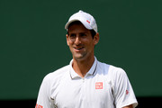 Novak Djokovic of Serbia smiles during the Gentlemen's Singles semi-final match against Juan Martin Del Potro of Argentina on day eleven of the Wimbledon Lawn Tennis Championships at the All England Lawn Tennis and Croquet Club on July 5, 2013 in London, England.