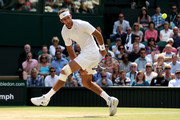 Juan Martin Del Potro of Argentina plays a shot through his legs during the Gentlemen's Singles semi-final match against Novak Djokovic of Serbia on day eleven of the Wimbledon Lawn Tennis Championships at the All England Lawn Tennis and Croquet Club on July 5, 2013 in London, England.