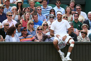 Juan Martin Del Potro of Argentina sits on a wall during the Gentlemen's Singles semi-final match against Novak Djokovic of Serbia on day eleven of the Wimbledon Lawn Tennis Championships at the All England Lawn Tennis and Croquet Club on July 5, 2013 in London, England.