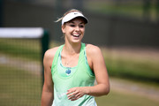 Sabine Lisicki of Germany smiles during a practice session on day eleven of the Wimbledon Lawn Tennis Championships at the All England Lawn Tennis and Croquet Club on July 5, 2013 in London, England.