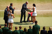 Marion Bartoli of France receives the Venus Rosewater Dish trophy from Prince Edward, Duke of Kent after her victory in the Ladies' Singles final match against Sabine Lisicki of Germany on day twelve of the Wimbledon Lawn Tennis Championships at the All England Lawn Tennis and Croquet Club on July 6, 2013 in London, England.