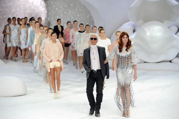 Karl Lagerfeld and models acknowledge the applause of the audience after the Chanel Ready to Wear Spring / Summer 2012 show during Paris Fashion Week at Grand Palais on October 4, 2011 in Paris, France.
