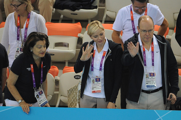 Charlene Wittstock (L-R) Yvette Lambert Berti, Princess Charlene and Prince Albert II of Monaco attend the swimming competitions at Aquatics Centre on July 29, 2012 in London, England.