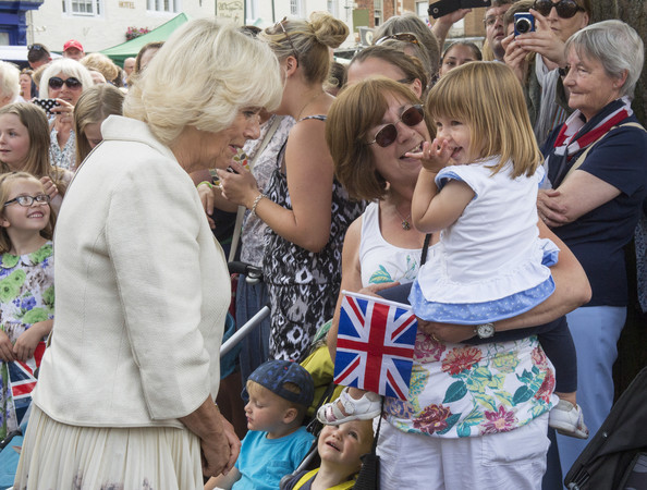 Camilla, Duchess of Cornwall meets members of the local community and business owners on July 28, 2014 in Oakham, England.
