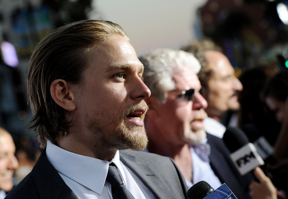 """Charlie Hunnam (L-R) Actors Charlie Hunnam, Ron Perlman and Kim Coates arrive at the premiere of FX's """"Sons of Anarchy"""" Season 6 at the Dolby Theatre on September 7, 2013 in Los Angeles, California."""
