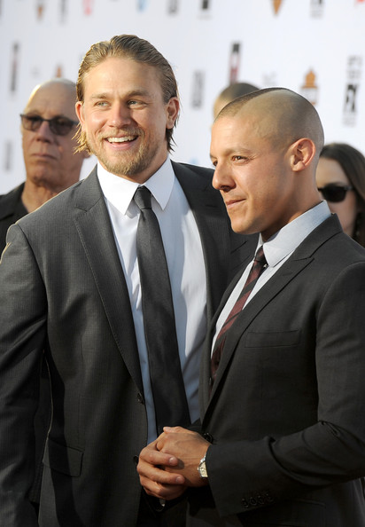 """Charlie Hunnam Actors Charlie Hunnam (L) and Theo Rossi attend the season 6 premiere of FX's """"Sons Of Anarchy"""" at Dolby Theatre on September 7, 2013 in Hollywood, California."""