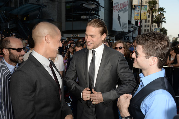 """Charlie Hunnam Actors Theo Rossi (L) and Charlie Hunnam (C) attend the season 6 premiere of FX's """"Sons Of Anarchy"""" at Dolby Theatre on September 7, 2013 in Hollywood, California."""