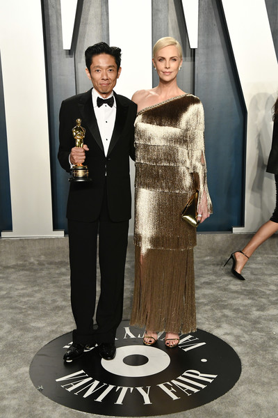 2020 Vanity Fair Oscar Party Hosted By Radhika Jones - Arrivals [suit,formal wear,tuxedo,dress,fashion,gown,event,haute couture,fashion design,style,radhika jones - arrivals,radhika jones,kazuhiro tsuji,charlize theron,beverly hills,california,wallis annenberg center for the performing arts,oscar party,vanity fair,kazuhiro tsuji,charlize theron,wallis annenberg center for the performing arts,oscar party,vanity fair,90th academy awards,celebrity,academy award for best makeup and hairstyling,actor]