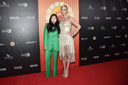 Awkwafina and Charlize Theron attend the Africa Outreach Project Fundraiser hosted by Charlize Theron at The Africa Center on November 12, 2019 in New York City.