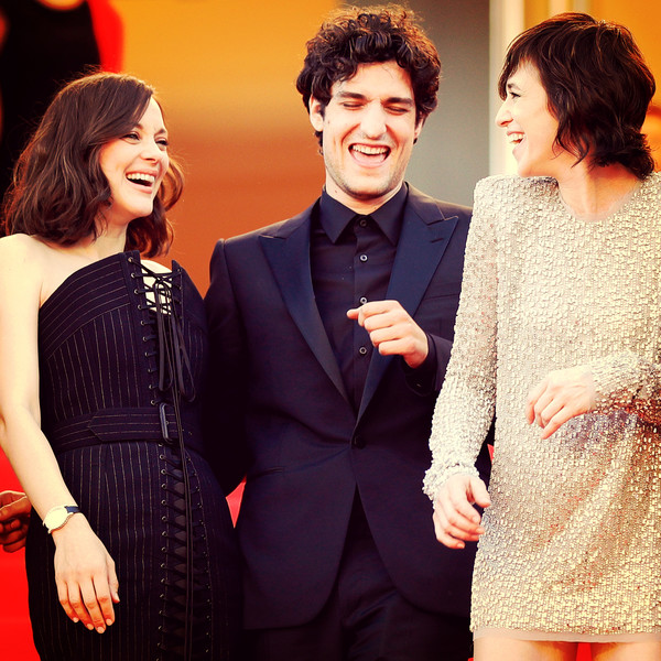Instant View - The 70th Annual Cannes Film Festival [image,facial expression,event,fashion,formal wear,friendship,suit,human,interaction,dress,smile,charlotte gainsbourg,louis garrel,marion cotillard,ismaels ghosts,filters,l-r,instant view - the 70th annual cannes film festival,screening,cannes film festival]