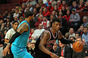 Jimmy Butler #21 of the Chicago Bulls drives around Mo Williams #7 of the Charlotte Hornets at the United Center on March 23, 2015 in Chicago, Illinois. The Bulls defeated the Hornets 98-86. NOTE TO USER: User expressly acknowledges and agrees that, by downloading and or using this photograph, User is consenting to the terms and conditions of the Getty Images License Agreement.
