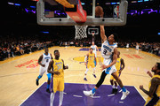 Jeremy Lamb #3 of the Charlotte Hornets dunks over Julius Randle #30 of the Los Angeles Lakers during the first half of a game at Staples Center on January 5, 2018 in Los Angeles, California.  NOTE TO USER: User expressly acknowledges and agrees that, by downloading and or using this photograph, User is consenting to the terms and conditions of the Getty Images License Agreement.