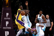 Marvin Williams #2, Kemba Walker #15 and Dwight Howard #12 of the Charlotte Hornets defend against Julius Randle #30 of the Los Angeles Lakers during the first half of a game at Staples Center on January 5, 2018 in Los Angeles, California.  NOTE TO USER: User expressly acknowledges and agrees that, by downloading and or using this photograph, User is consenting to the terms and conditions of the Getty Images License Agreement.