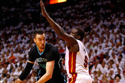 Cody Zeller #40 of the Charlotte Hornets drives on Luol Deng #9 of the Miami Heat during Game Seven of the Eastern Conference Quarterfinals of the 2016 NBA Playoffs at American Airlines Arena on May 1, 2016 in Miami, Florida. NOTE TO USER: User expressly acknowledges and agrees that, by downloading and or using this photograph, User is consenting to the terms and conditions of the Getty Images License Agreement