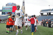 Kevin Drew #19 of the Charlotte Hounds makes his way onto the field before a game between the Charlotte Hounds and the Boston Cannons April 26, 2015 at Gillette Stadium in Foxboro, Massachusetts.