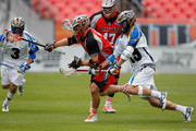 Noah Molnar #12 of the Colorado Outlaws controls the ball against Kevin Drew #19 of the Charlotte Hounds at Sports Authority Field at Mile High on May 3, 2015 in Denver, Colorado. The Outlaws defeated the Hounds 15-12.