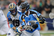 Kevin Drew #19 of the Charlotte Hounds knocks the ball free from Kyle Harrison #18 of the Ohio Machine at Selby Stadium on May 16, 2015 in Delaware, Ohio.